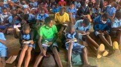1, 600 St. Kizito Pupils Sit on Floor