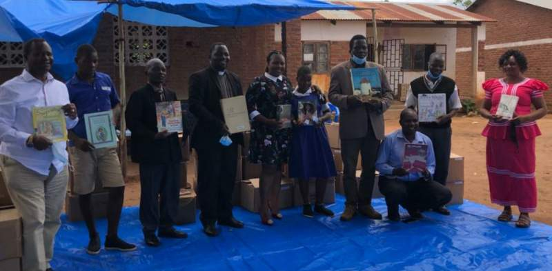 For the reading culture; beneficiaries and donors pose for the books