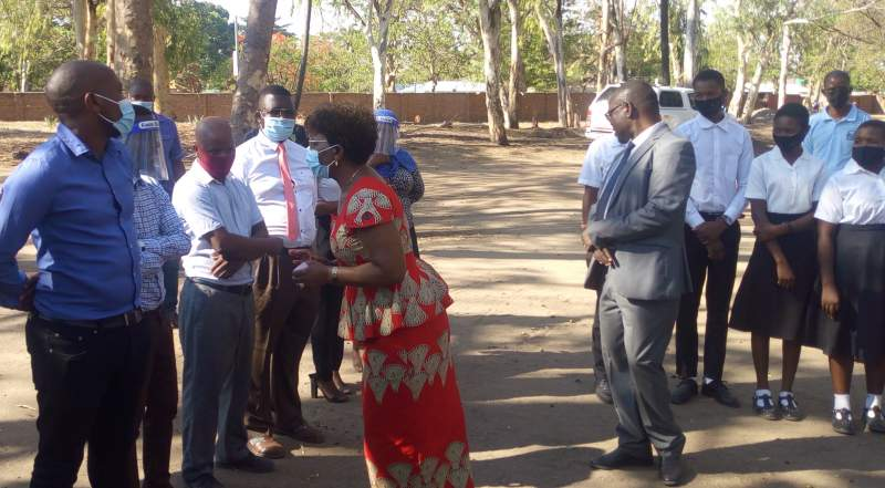 Nyalonje interacting with students and officials at Mangochi Secondary School