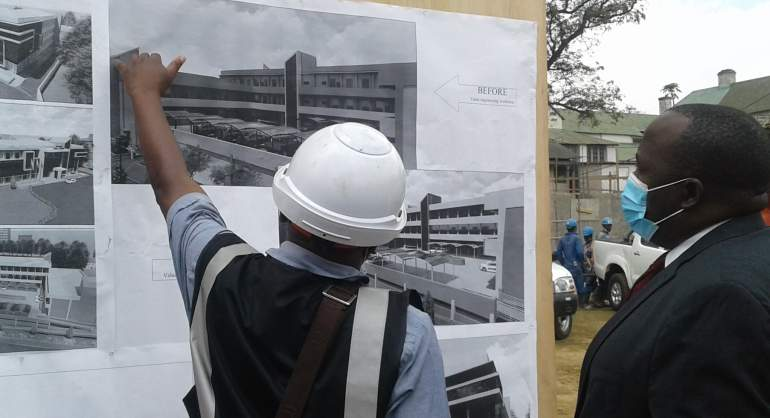 Banda (right) appreciating the architectural work of the project