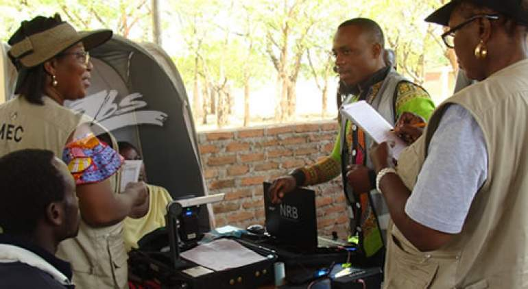 Dr. Ansah (left) inspecting voter registration exercise in last year's elections