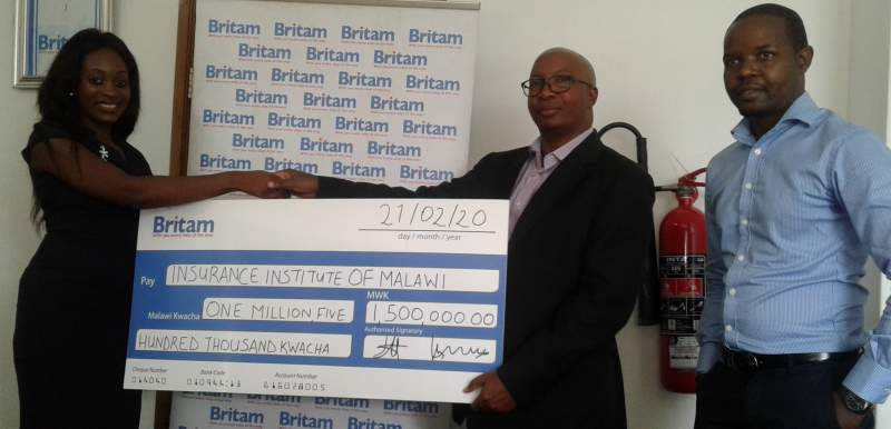 Mwenechanya presenting the dummy cheque to Dzoole Mwale