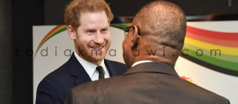 APM: Takes the hand of Prince Harry