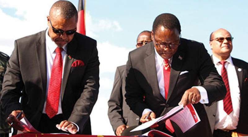 UTM President, Saulos Chilima (left) and MCP counterpart, Lazarus Chakwera signing the agreement in Lilongwe on March 19th, 2020