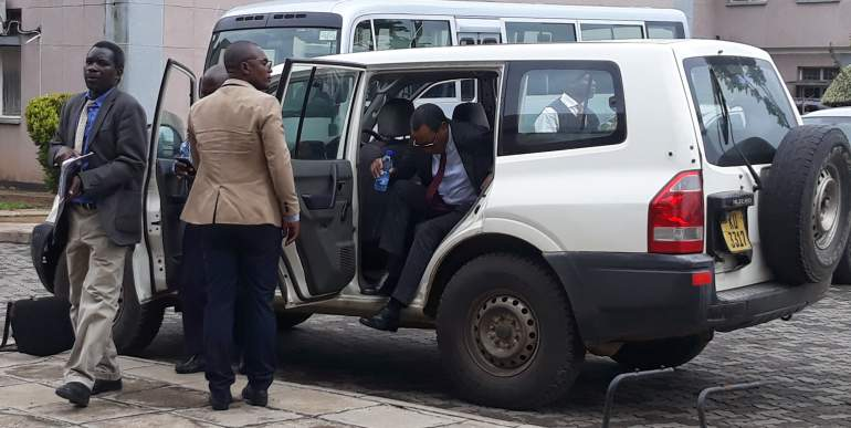 Dr. Mpinganjira arriving at the court