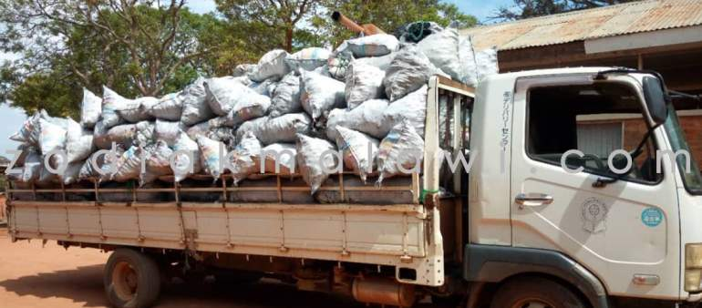 Truck loaded with bags of charcoal imported from Zambia