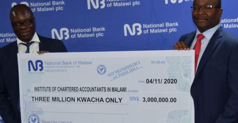 Dr. Gondwe (left) receiving a dummy cheque from Katsala