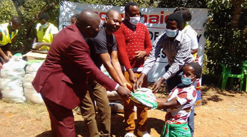 Action Aid Malawi and Neno district council officials in a symbolic distribution