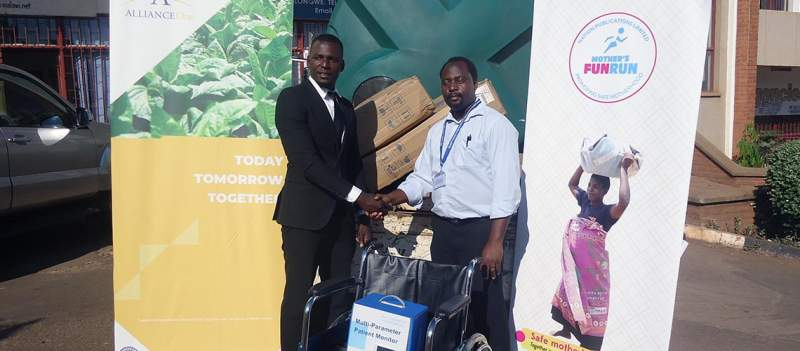 Kawonga (left) making a symbolic handover of the equipment to Jere
